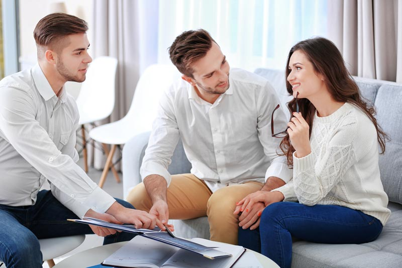Advisor discussing plans with couple